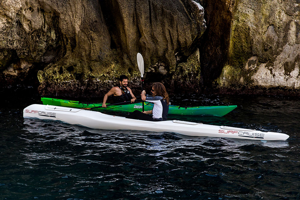 due canoe kayak Surfcurise e kayak mare, uomo e donna pagaiare